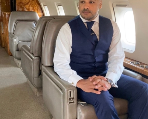 Photo of Jason Humble sitting in a private jet